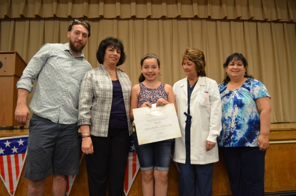 P.S. 277 5th grader Layla Avery, center, accepting her award. (Photo: Alex Ellefson / Sheepshead Bites)